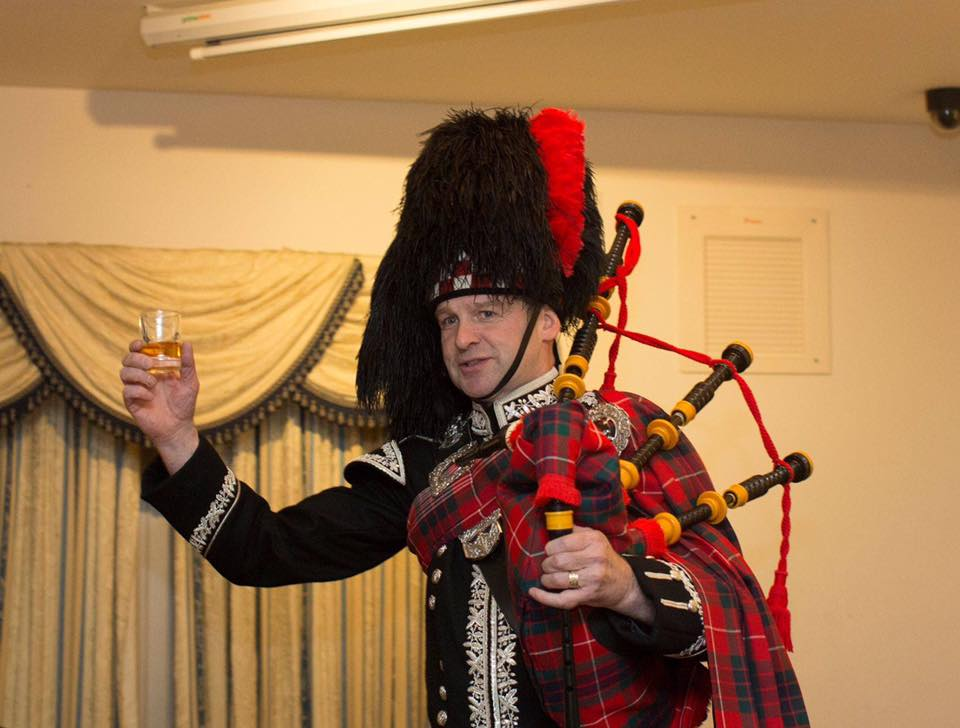 Spud the Piper with a whisky toast